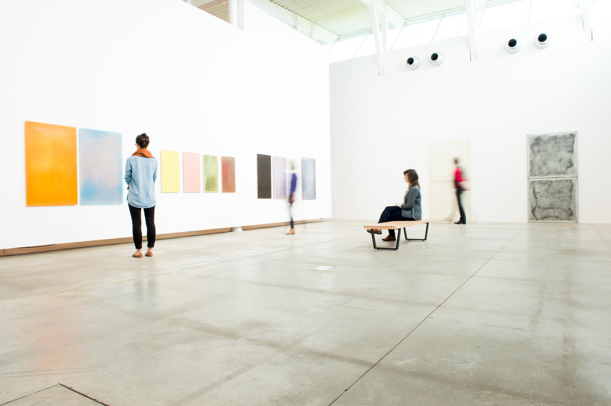 students in a bright art gallery