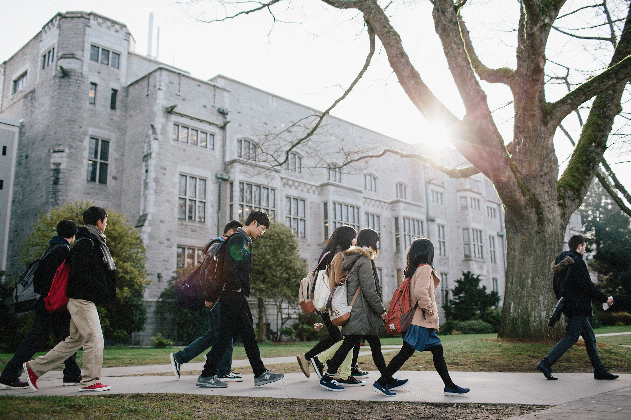large group of students walking on campus