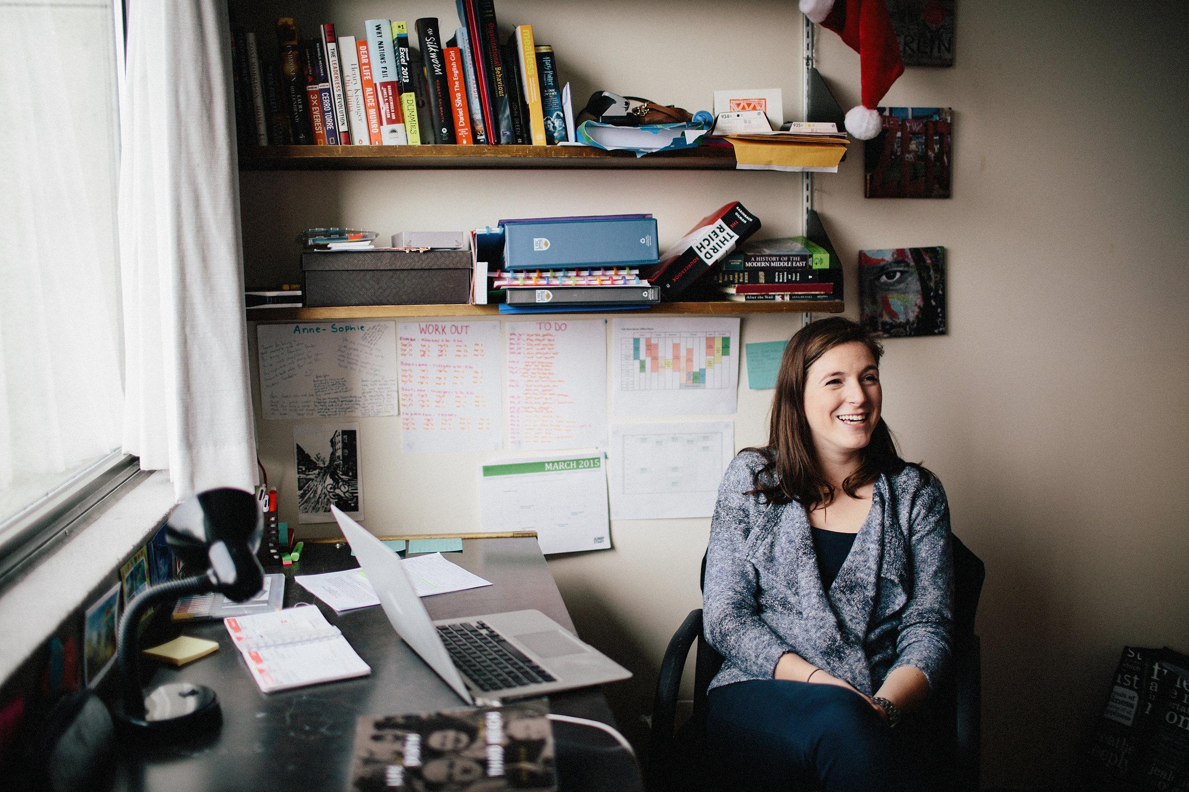 student in dorm sitting at desk