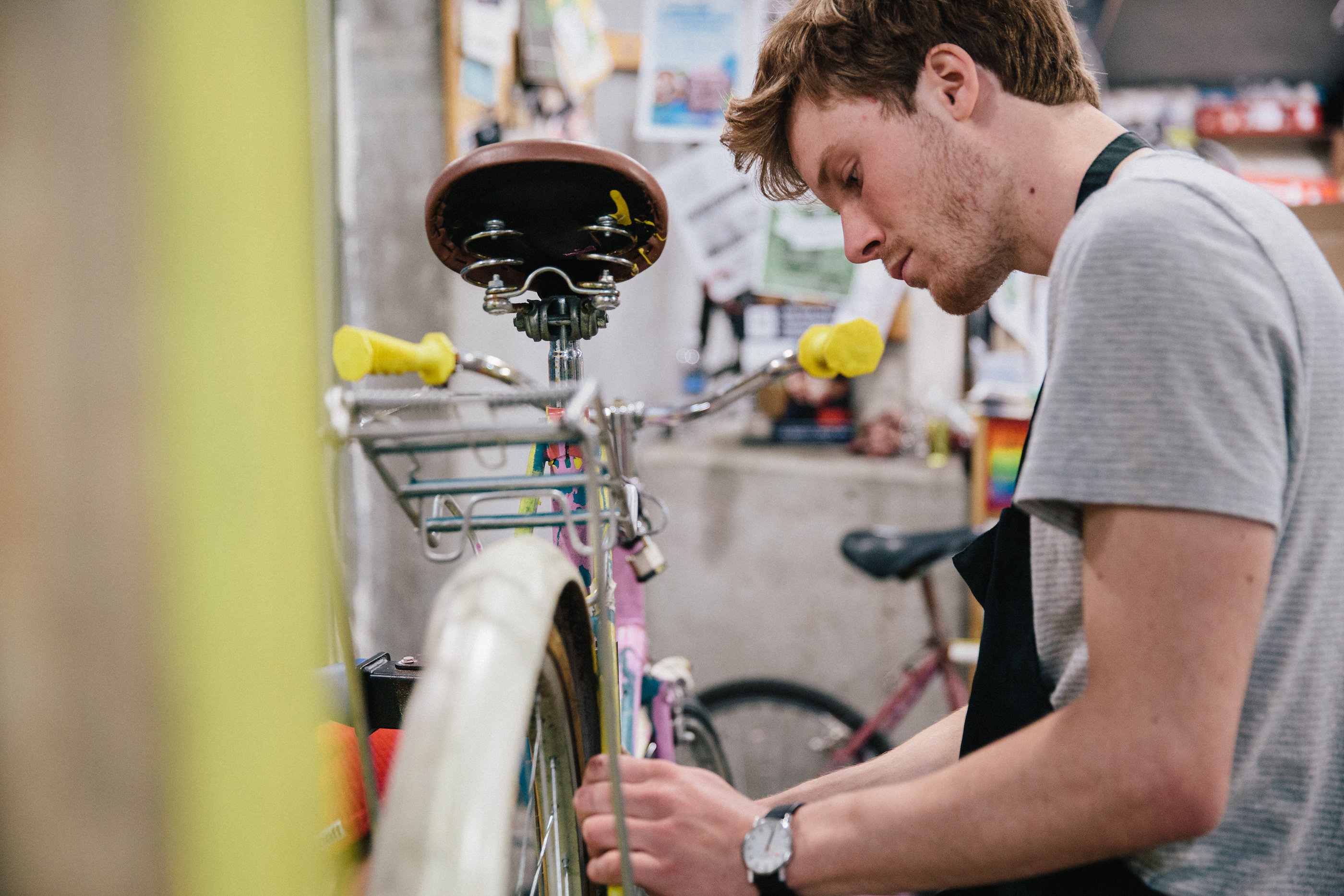 Volunteer fixing a bike in the Bike Kitchen