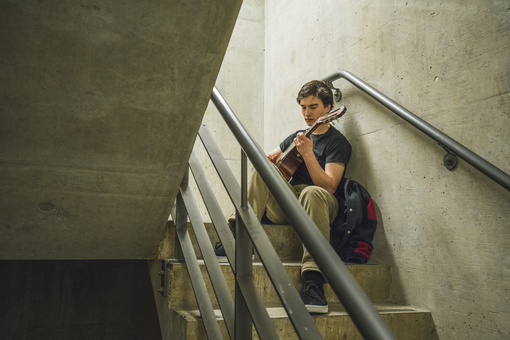Robby playing his guitar in a stairwell at UBC Vancouver.