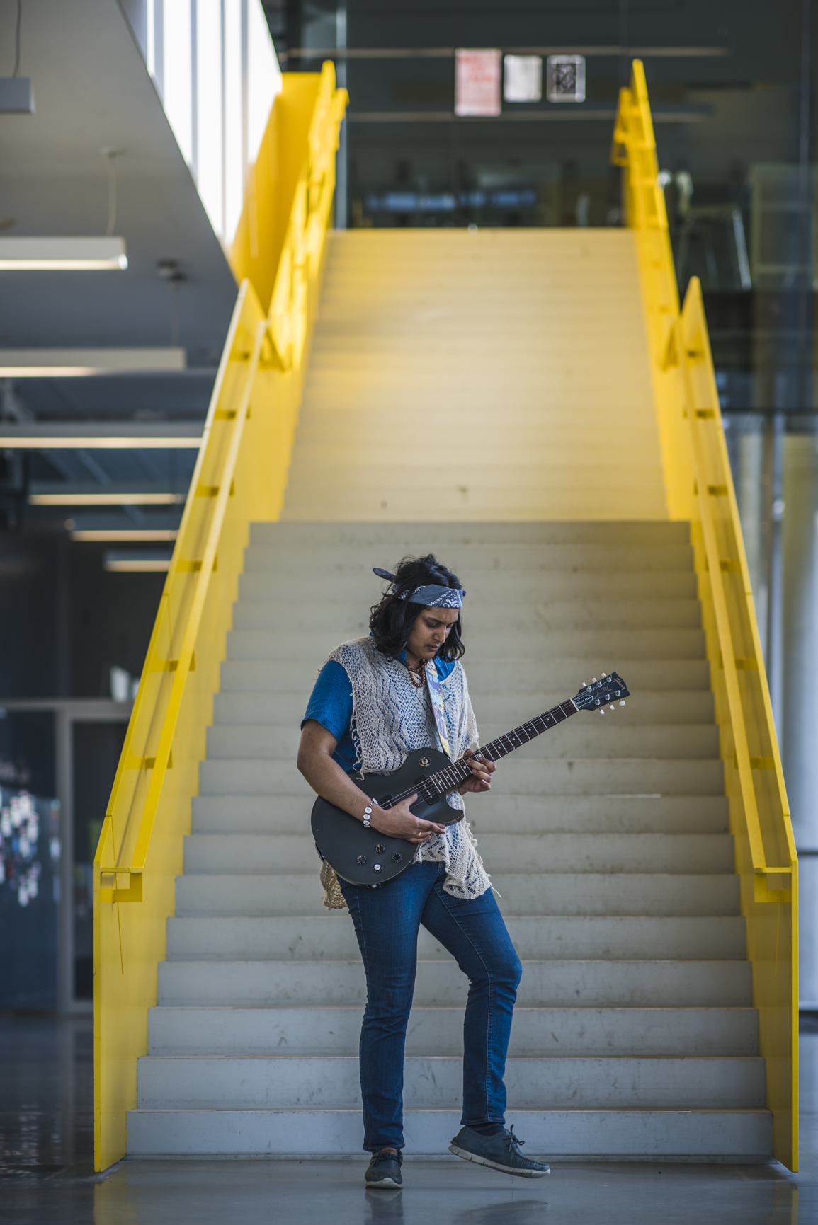 Sharang playing his guitar inside the UBC Life building.