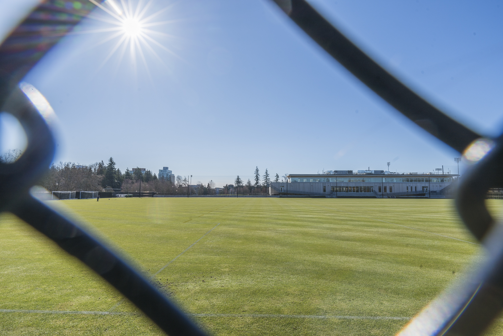 A sports field on a sunny day at UBC Vancouver.