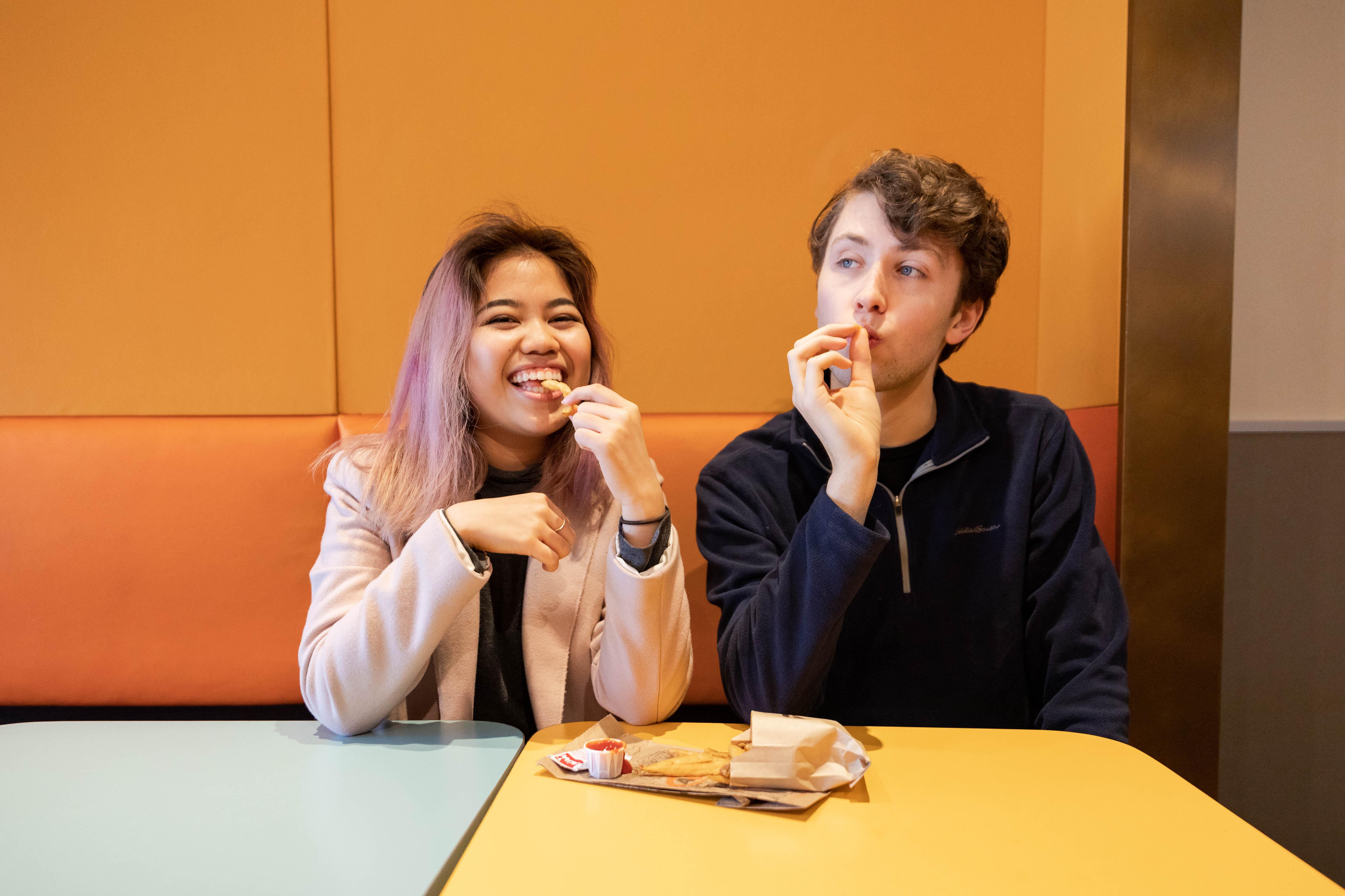 Sara and Jordan eating fries