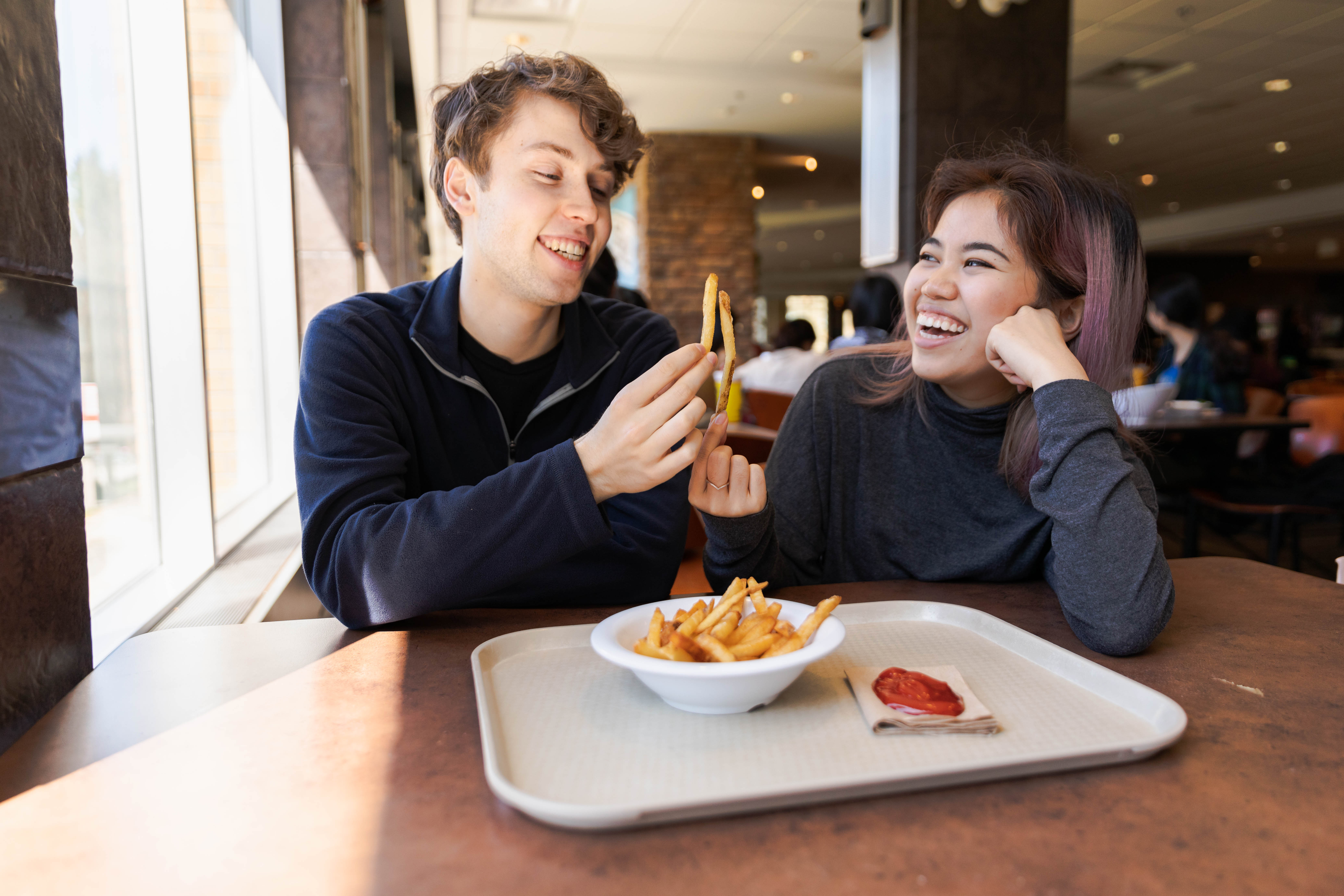 Jordan and Sara cheers-ing their fries