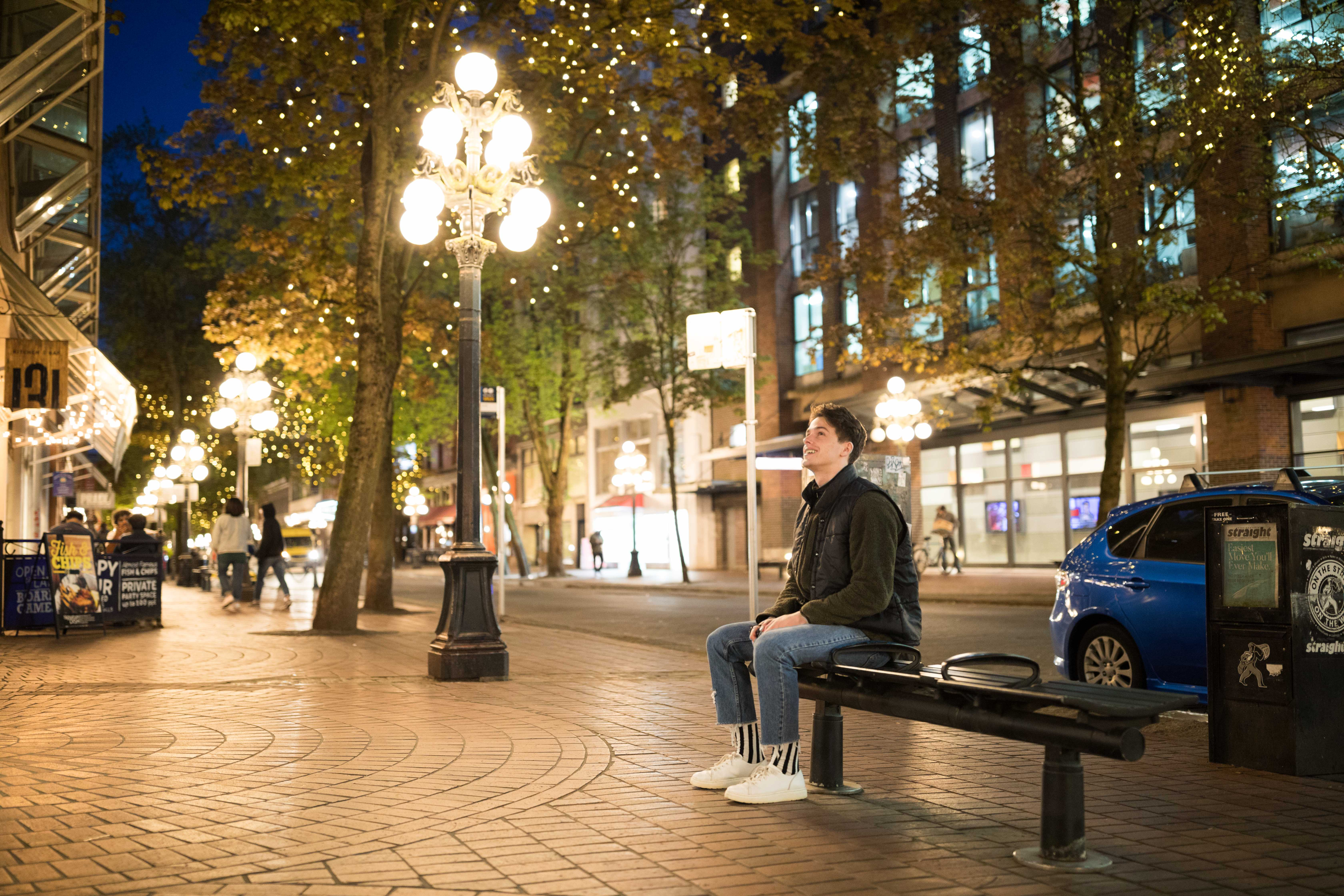 student sitting on a bench in gastown