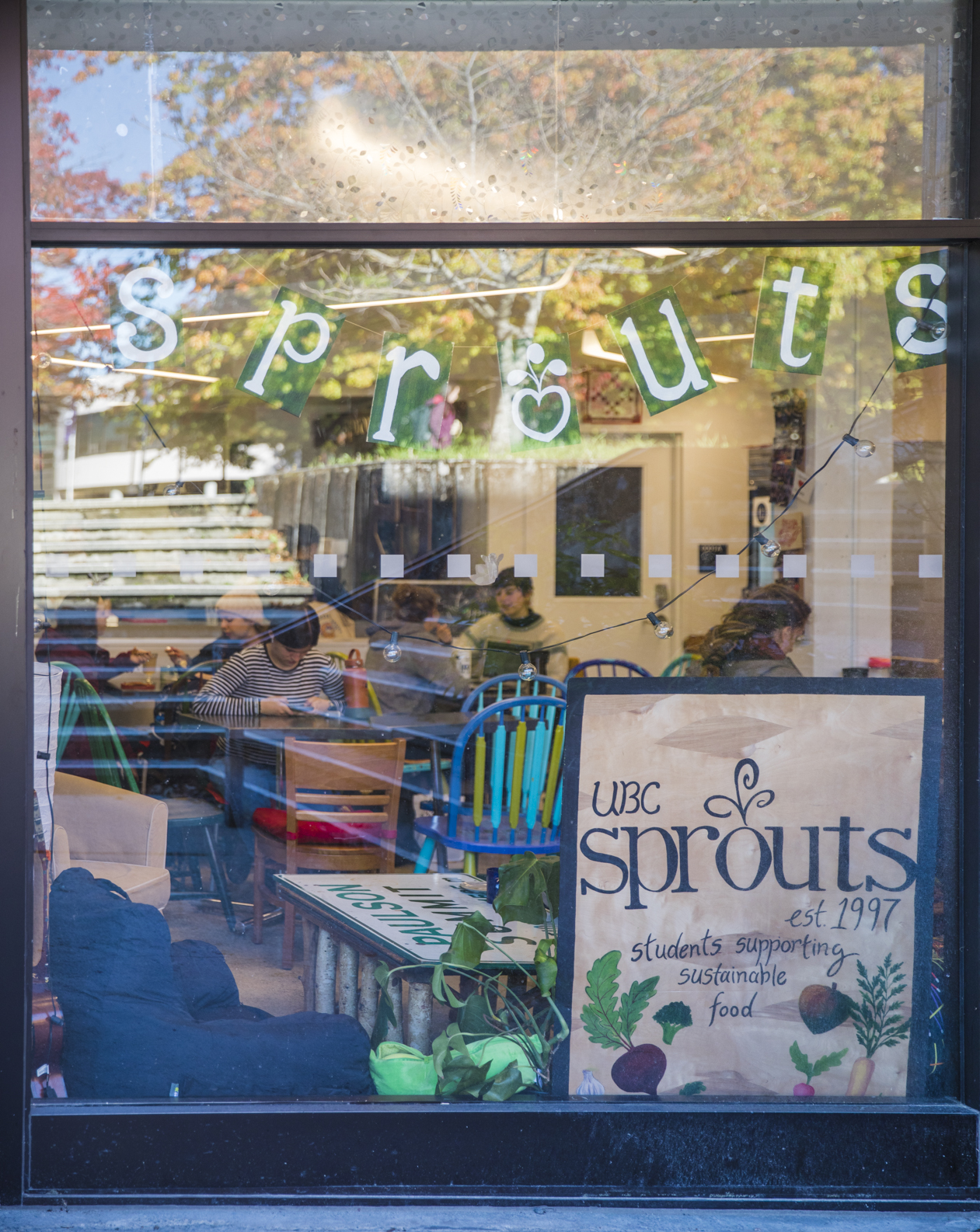 Students sitting and eating inside Sprouts.