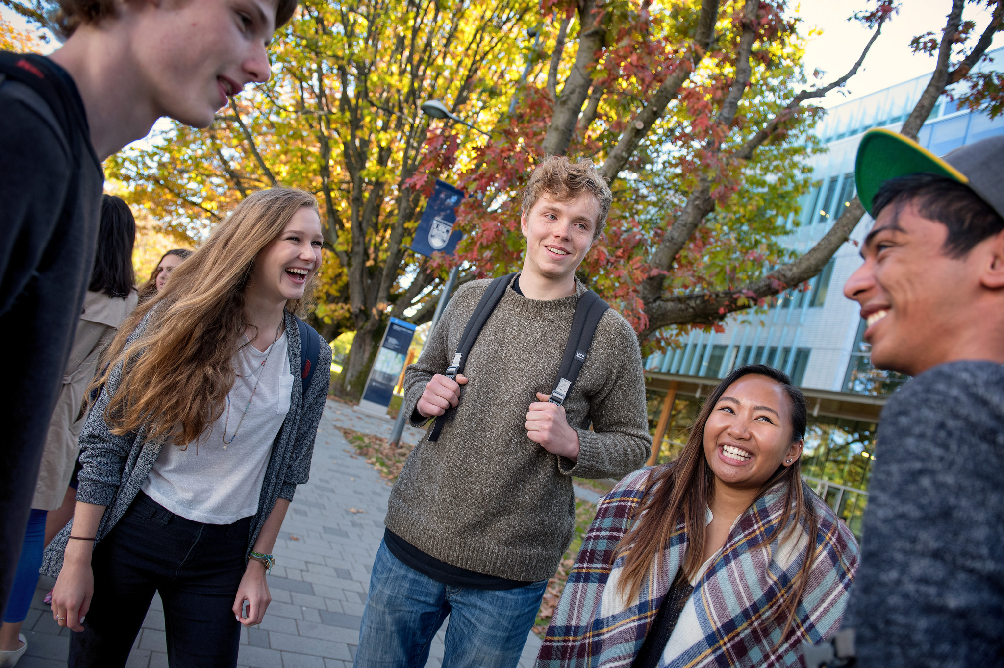 A group of students laughing on Main Mall