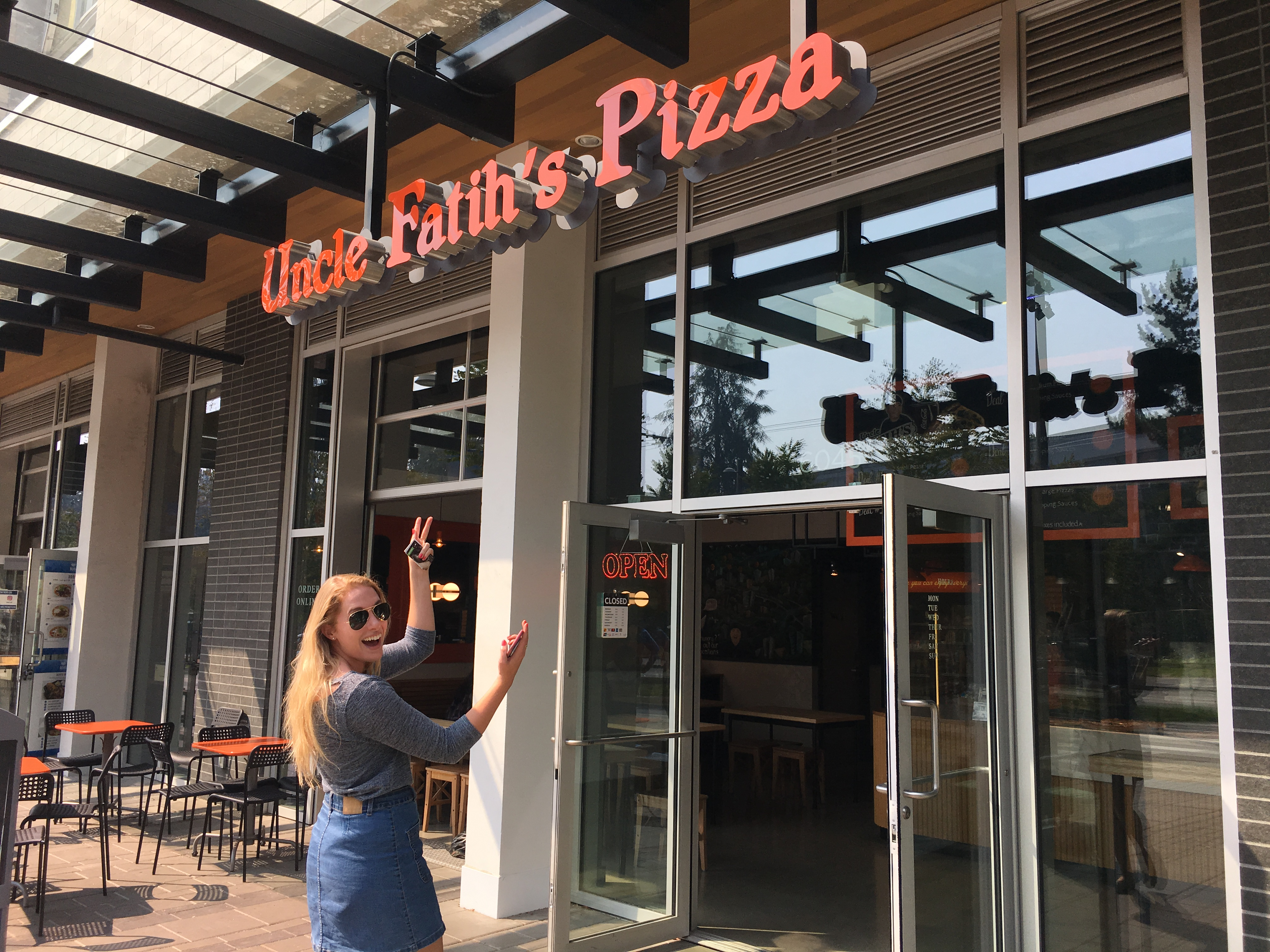 Sarah pointing at Uncle Fatihs Pizza