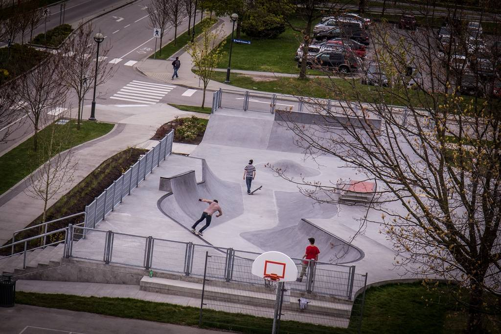 aerial shot of three skateboarders at the skatepark