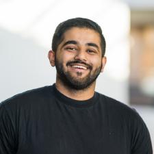 Headshot of Taher