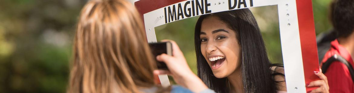 2 students taking photos at imagine day