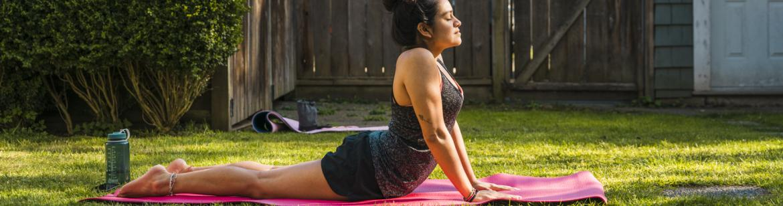 student doing yoga in the backyard