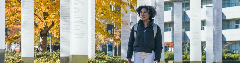 Student walking towards the Robert H. Lee Alumni Centre