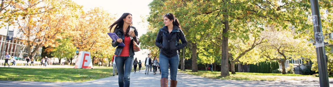 Students walking around campus on a spring day