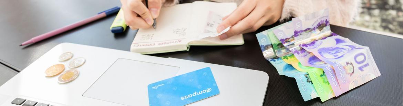 student managing money at her desk