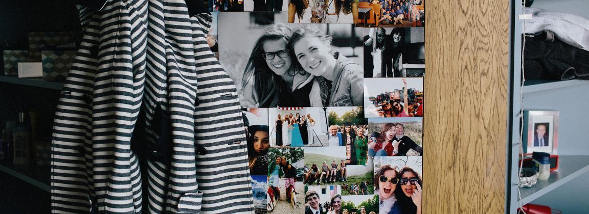 Roommate photos up on a dorm room wall