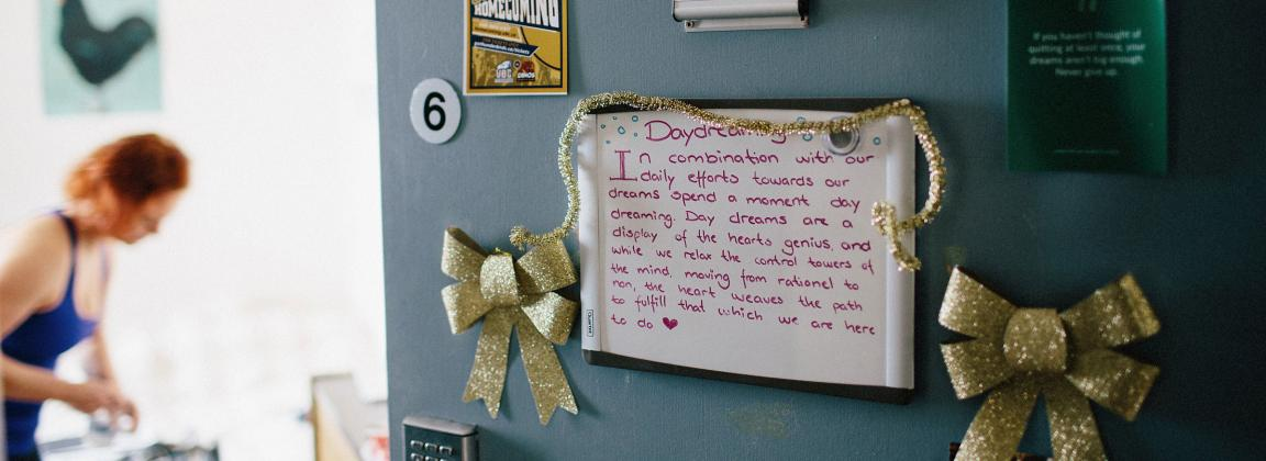Dorm room door decorated with pictures and cards