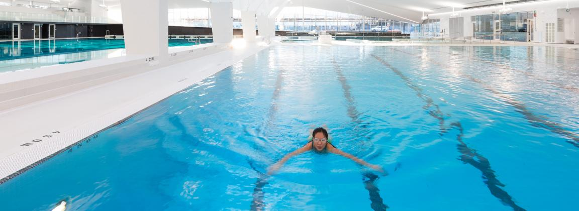 Student swimming in the new UBC Aquatic Centre Pool