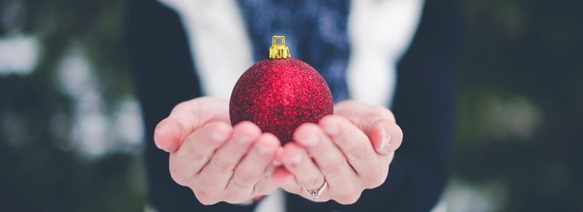 Student holding a Christmas ornament
