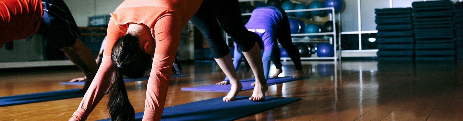 Student stretching on yoga mats