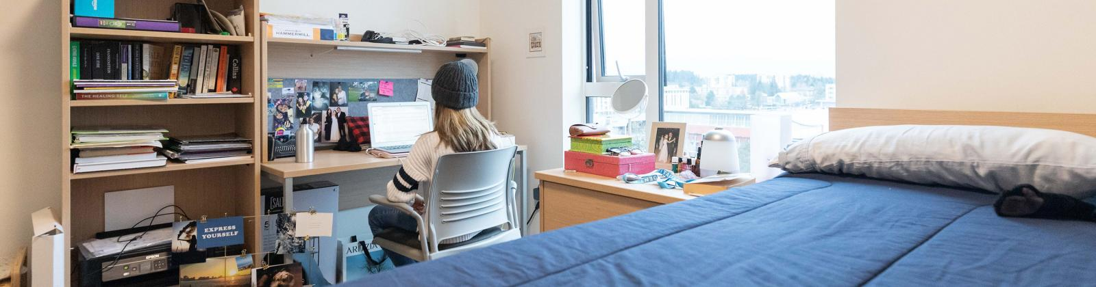 A student is studying in her room