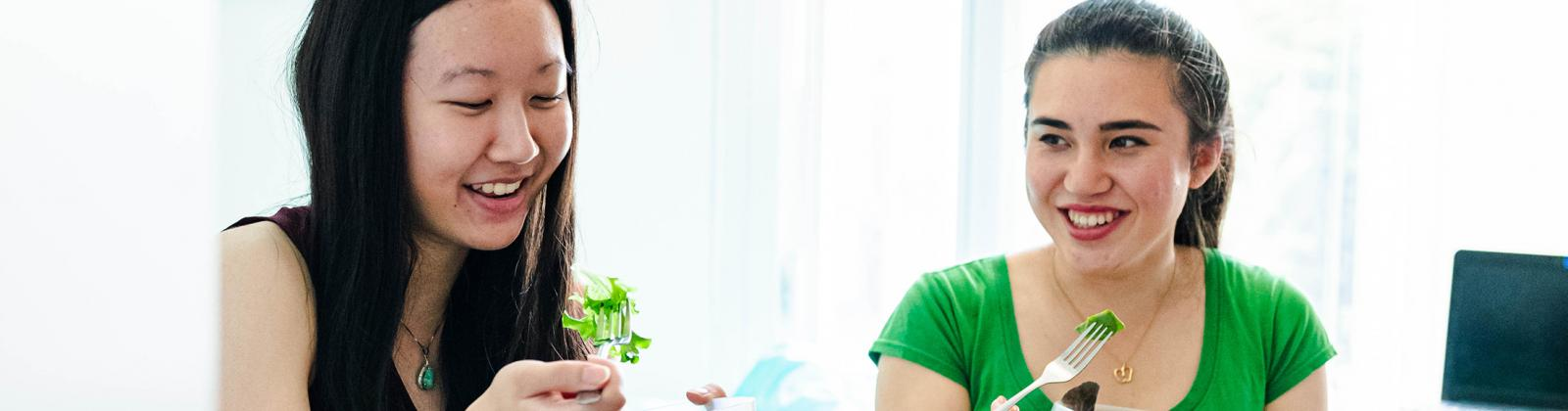 student eating salad