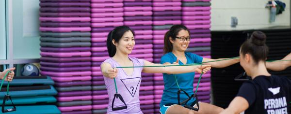 Students stretching in an instructor-led recreation class