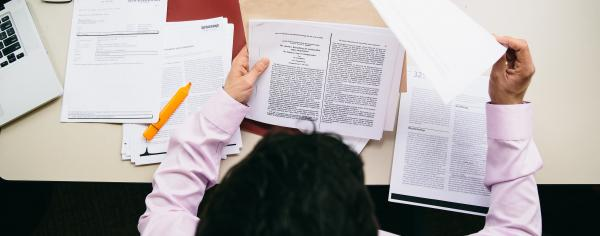 Student looking through articles