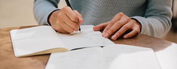 A student writing in a notebook