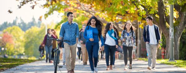 Students walking outside on a sunny fall day at UBC