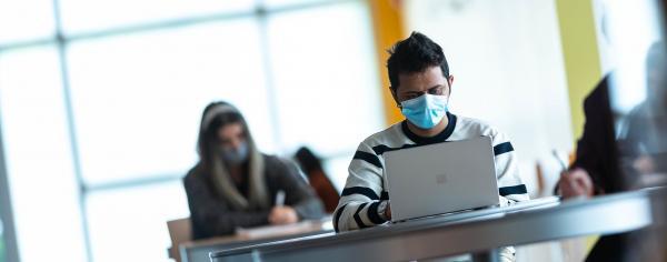 Student on laptop in IKBLC