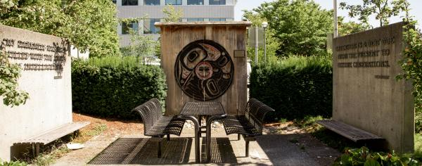 The Raven Brings the Light mural carved by Haida artist and former UBC student, Bernard Kerrigan.