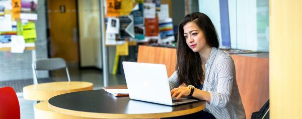 Student on laptop registering for classes