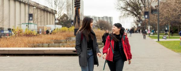 two students walking down university blvd