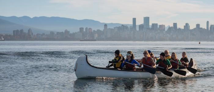 UBC students dragon boating in the ocean