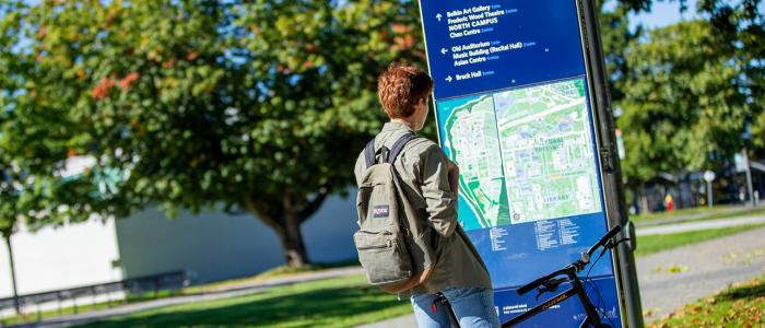 UBC student looking at a map on campus