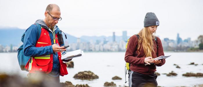 UBC student and professor gathering field data by the ocean