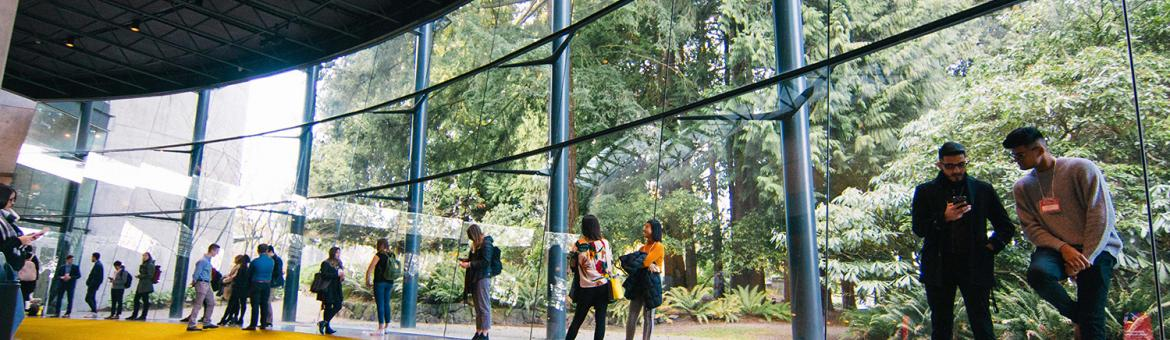 Students standing in the Chan Centre Glass Atrium