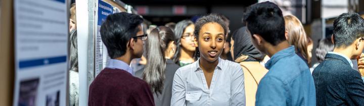 Students at a poster presentation
