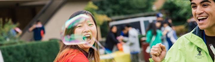 Female student playing with bubbles