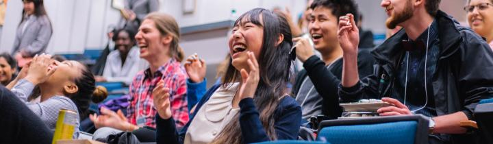 Students laughing and enjoying an improv show