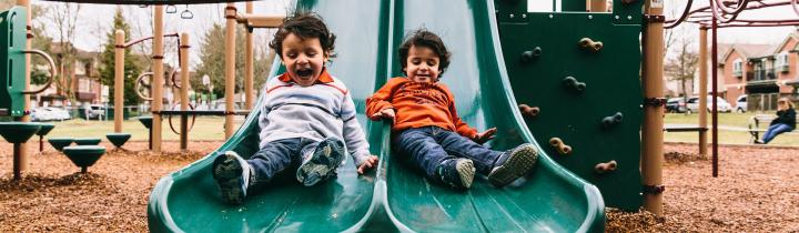 Children going down a slide