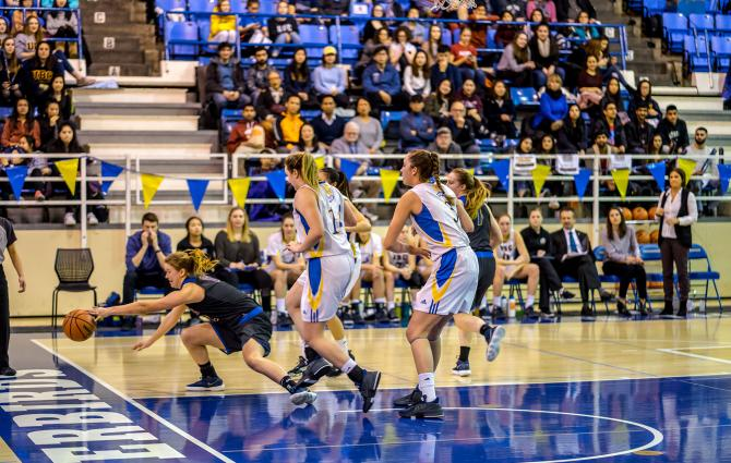 Courtside Thunderbird players from the Women's team