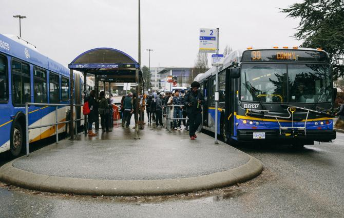Students taking the 99-Bline bus at UBC Bus Loop
