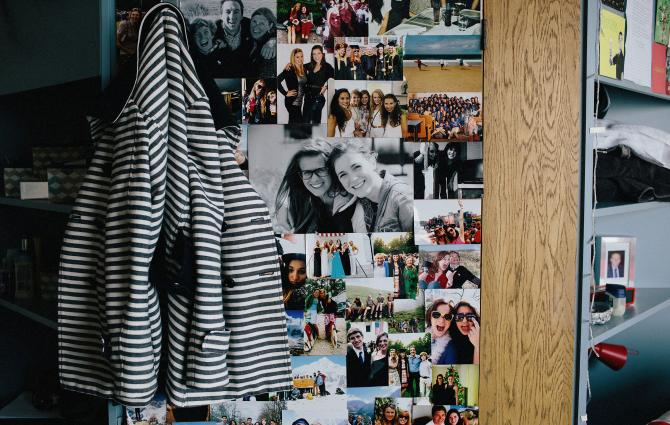 Roommate photos up on a dorm room wall