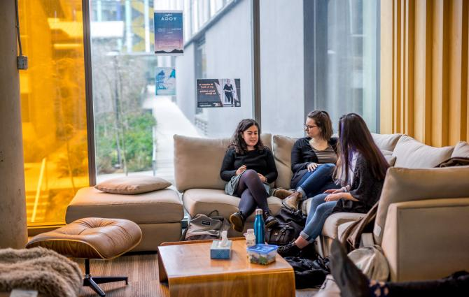 Students chatting on a couch in a UBC's Collegia