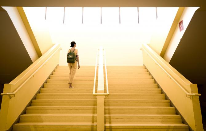 Student going up the stairs