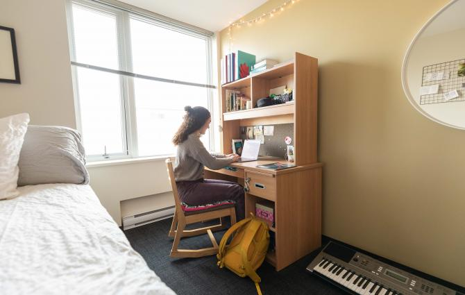 A student in a residence room