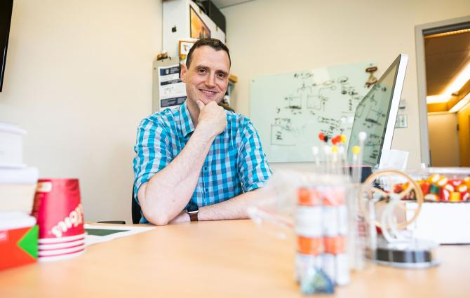 Prof Jason Hein sitting in his office at UBC Vancouver